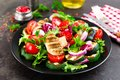 Salad with fresh and grilled vegetables and mushrooms. Vegetable salad with grilled champignons. Vegetable salad on plate Royalty Free Stock Photo
