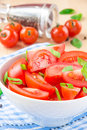 Salad from fresh tomatoes spring green onions and black pepper in white bowl Royalty Free Stock Photo