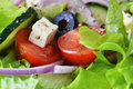 Salad with fresh vegetables feta cheese and close up Stock Photos