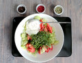 Salad - fresh vegetables and greens - dressed with white cream sauce. Three colored peppers in corns - green, rose an Royalty Free Stock Photo