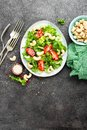 Salad with fresh vegetables and nuts. Vegetable salad with fresh vegetables and cashew. Vegetable salad on plate Royalty Free Stock Photo