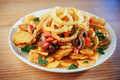 Salad with fried potatoes, mushrooms and tomatoes Royalty Free Stock Photo