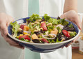 Salad with fruit and peanuts green in a bright environment Royalty Free Stock Images