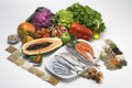 Salad fruits fishes and cereals assembled on a white background Royalty Free Stock Photos