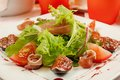 Salad with gammon and figs tomato and lettuce in a restaurant Royalty Free Stock Images