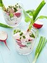 Salad glasses with radish cottage cheese shallow dof Stock Photo