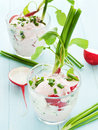 Salad glasses with radish cottage cheese shallow dof Stock Photos