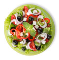 Salad on a green plate isolated white background Royalty Free Stock Photo