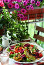 Salad with grilled chicken mango bell peppers tomatoes and lettuce lunch in the balcony spring mix lime wedges Royalty Free Stock Photography
