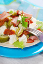 Salad with ham feta and vegetables plate of fresh parma cheese Royalty Free Stock Photography