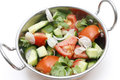 Salad in indian kadai bowl tomato cucumber and sliced shallot served a Royalty Free Stock Images