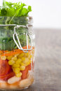 Salad in jar on wood Stock Images