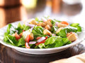 Salad with lettuce tomato and croutons shot close up selective focus Royalty Free Stock Photos