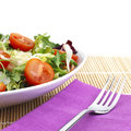 Salad lunch with tomato and cheese over placemat Royalty Free Stock Photography