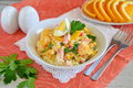 Salad made of orange, crab meat, eggs, corn served with yogurt in a white bowl on a cloth background. Simple food Royalty Free Stock Photo