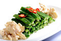 Salad made of walnut kernel and vegetable chinese food on a white plate Stock Images