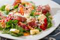 Salad with meat and tomatoes