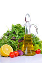 Salad mix with rucola frisee radicchio lettuce and bottle of olive oil lemon tomatoes Stock Photos