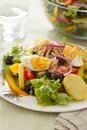Salad nicoise tuna with eggs potatoes green beans tomatoes onions and black olives Stock Photo