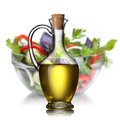 Salad and oil isolated on white Royalty Free Stock Photo