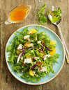 Salad with oranges arugula walnuts and blue cheese Stock Photo