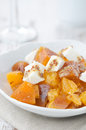 Salad with persimmon, mandarin oranges and goat cheese vertical Royalty Free Stock Photography