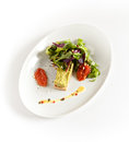 Salad in plate vegetarian with tofu on a white on a white background Stock Photos