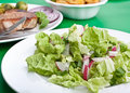 Salad with pork chops with fries Royalty Free Stock Images