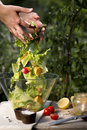Salad preparation on a traditional wooden table outdoors Royalty Free Stock Image