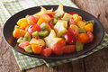 Salad of ripe tropical fruits close-up on a plate. horizontal Royalty Free Stock Photo