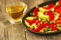 Salad of roasted peppers and avocado on a wooden background Stock Photos