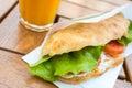 Salad sandwich with tomato slices and orange juice Royalty Free Stock Photo