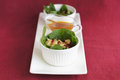 Salad with sauce from spinach dry cranberry cheese and walnut yellow sause in sauseboat Stock Photos