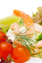 Salad of shrimp, mixed greens,tomatoes. Stock Image