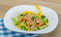 Salad with shrimps and avocado icberg yellow pepper Royalty Free Stock Photo