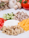 Salad from sliced vegetables meat and champignon with garnish o on white plate Royalty Free Stock Images