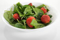 Salad spinach with strawberries on white background Royalty Free Stock Images