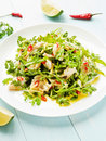 Salad with steamed sea bass fillet chili pepper rucola cilantro and ginger in olive and linseed oil shallow dof Stock Photography