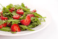 Salad with strawberry plate of herbs and over white background Stock Images