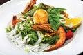 Salad with tiger shrimps pesto sauce sea escallope squid light green mix Royalty Free Stock Image
