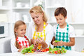 Salad time with the kids in the kitchen healthy life education Royalty Free Stock Images