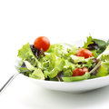 Salad with tomato over white background Stock Photo