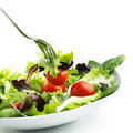 Salad with tomato over white background Stock Photography