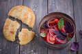 Salad of tomato, red onion, basil and mint with sesame flat bread Royalty Free Stock Photo