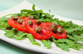 Salad with  tomatoes, capers and arugula Royalty Free Stock Photo