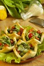 Salad with tomatoes and cheese in tartlets Stock Images