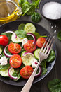 Salad with tomatoes cucumber and goat cheese a Stock Photos