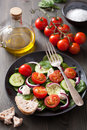 Salad with tomatoes cucumber and goat cheese Stock Images