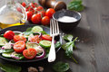 Salad with tomatoes cucumber and goat cheese fresh Royalty Free Stock Images