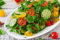 Salad of tomatoes, cucumbers, peppers, arugula and dill.
